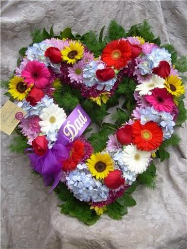 A heart-shaped Wreath with Hydrangea, Gerbera and Sunflower.