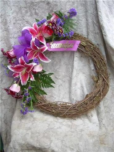 Grapevine wreath with swag