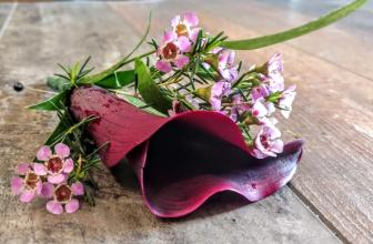 BURGANDY MINI CALLA BOUT WITH WAXFLOWER