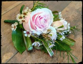 PINK ROSES AND TROPICAL FOLIAGE BOUTONNIERE