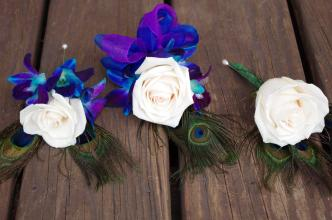 Peacock corsage and boutonierres