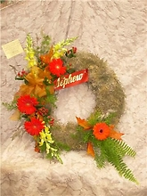 Wreath of Spanish moss with swag